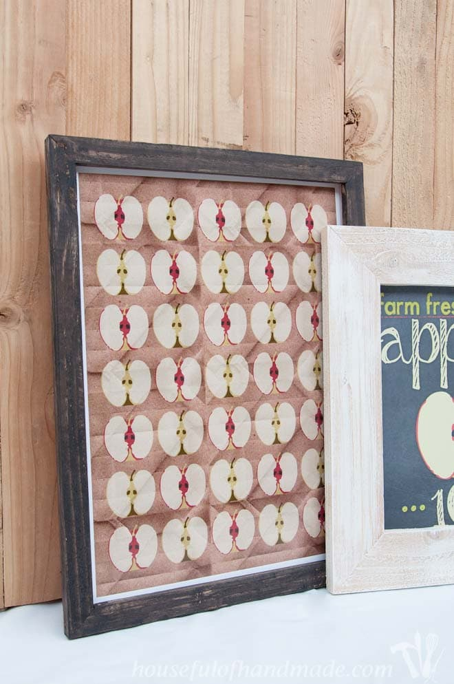 two diy rustic picture frames with apple printables shown on mantel